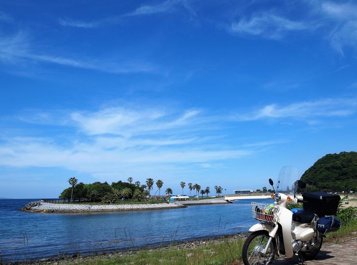 Beauty In Nature Blue Cloud - Sky Cub Honda Super Cub Land Vehicle Mode Of Transportation Nature Plant Real People Sky Transportation Travel Water