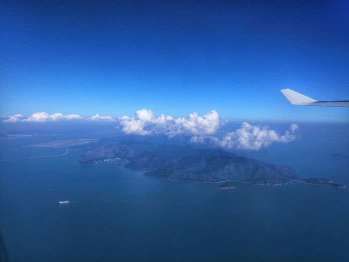 Saying farewell to Hong Kong. HongKong Behind The Window Plane Ride Home On Board The Plane Cathay Pacific Throwback Wednesday Wednesday Sky Clouds And Sky