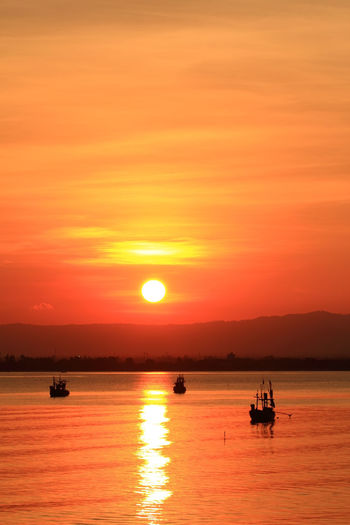 Long tailed boat at sunset , south of Thailand Nautical Vessel Sunset Water Transportation Sky Mode Of Transportation Orange Color Scenics - Nature Sea Beauty In Nature Sun Waterfront Tranquil Scene Silhouette Tranquility Idyllic Sailing Nature Reflection No People Outdoors Horizon Over Water