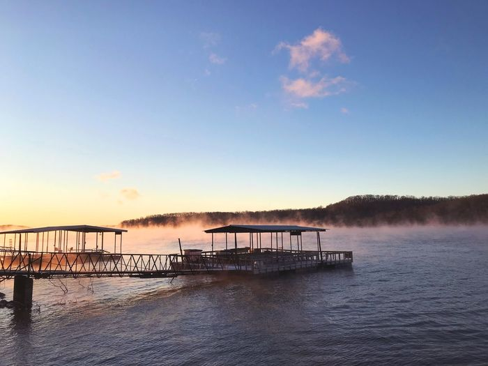 Fog rising on the lake Lake Of The Ozarks Missouri Dock Fog Landscape Water Sky Sunset Nature Beauty In Nature Scenics Sea Outdoors Tranquility Tranquil Scene No People Cloud - Sky Day Architecture