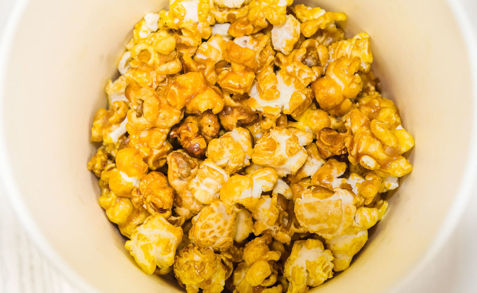 Popcorn in a paper bucket Popcorn Food Delicious Movıe Watching A Movie Eating Snacktime Corn EyeEm Selects High Angle View Yellow Food Directly Above No People Food And Drink Healthy Eating Indoors  Close-up Day Ready-to-eat