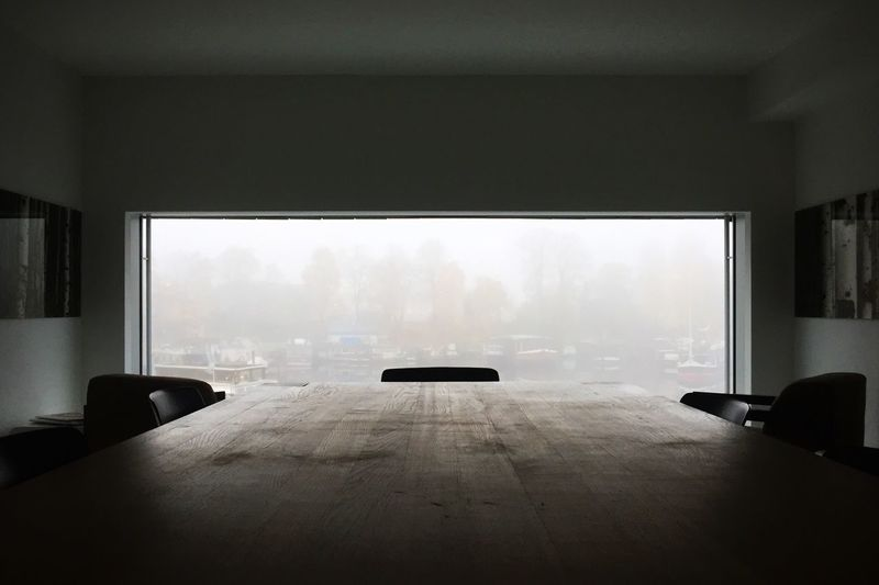 Conference table against window