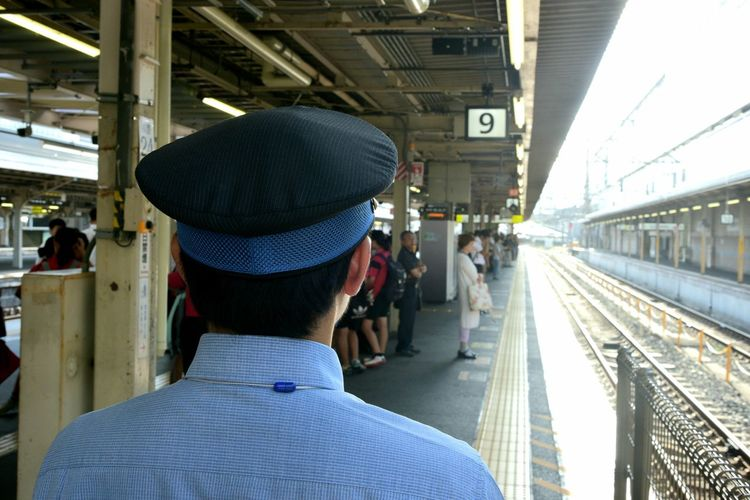 Rear view of people on railroad station