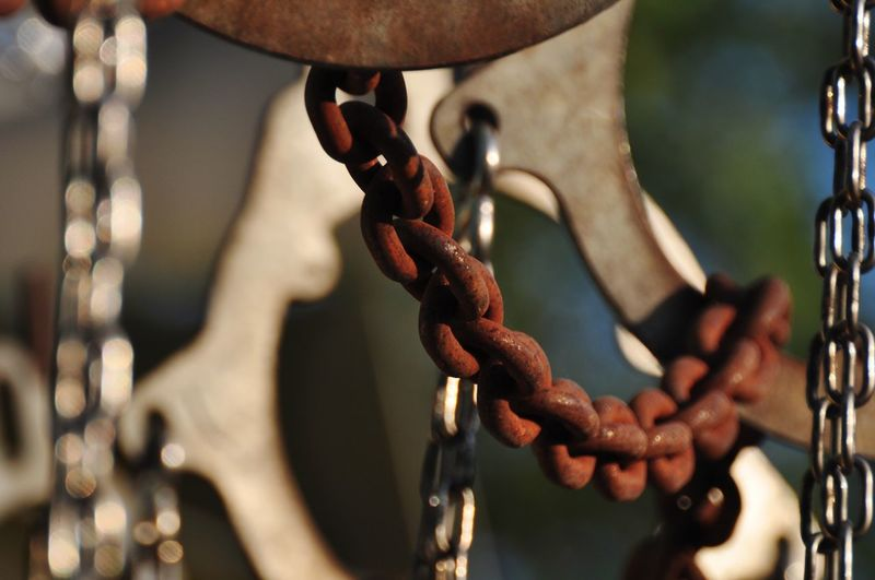 Close-up of chain hanging on metal