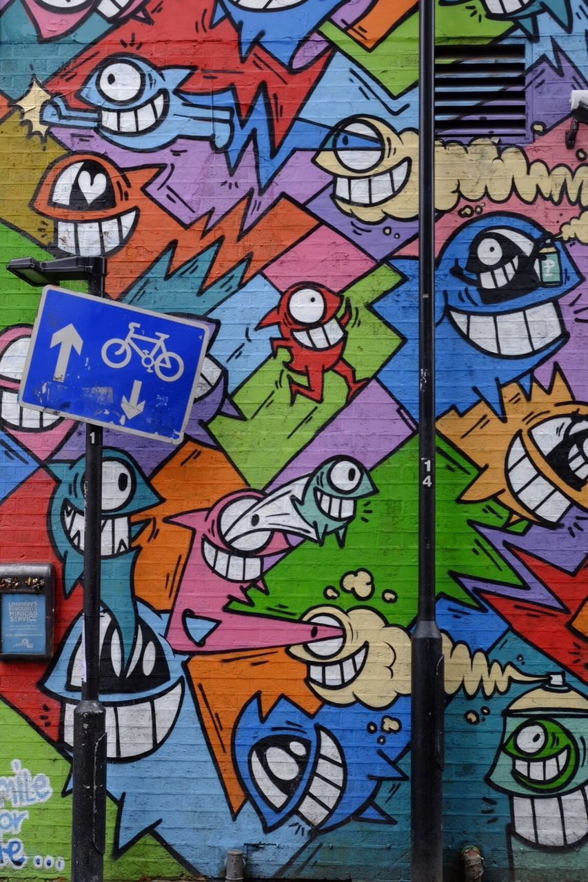 multi colored, art and craft, graffiti, creativity, window, day, built structure, no people, architecture, close-up, outdoors