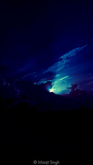Scenic view of silhouette landscape against sky at night