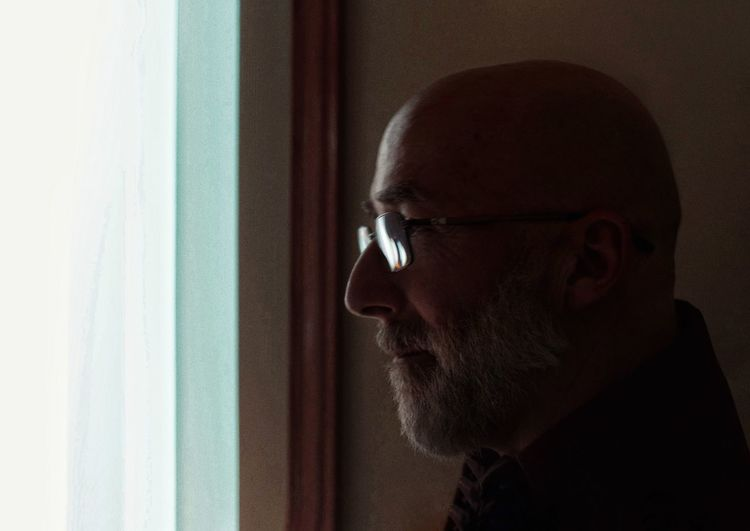 Men Eyeglasses  Headshot Shaved Head Beard Mid Adult Contemplation Mature Men Close-up Introspection Eyelid Day Dreaming Looking Through Window Thoughtful Worried Window Sill Pretty Thinking