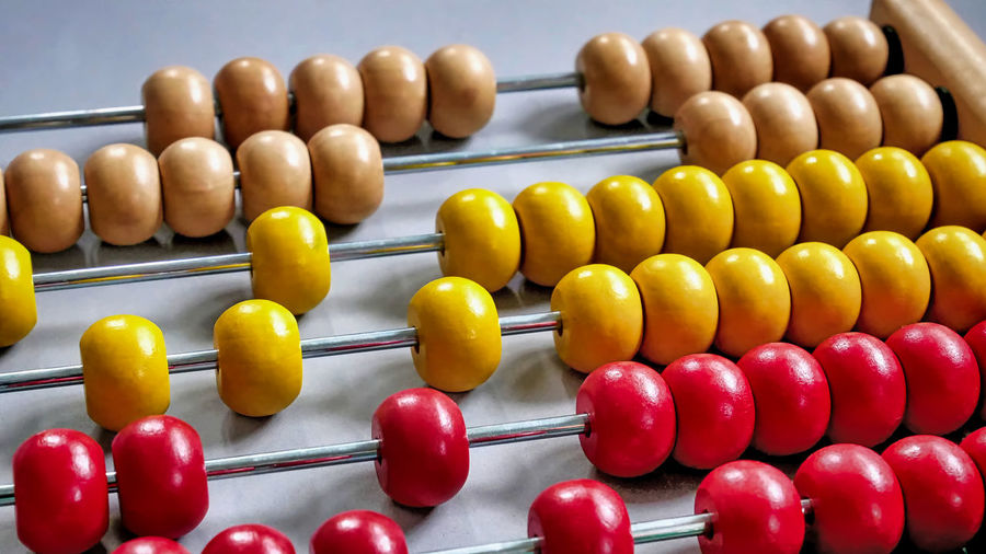 Colorful Wooden Abacus Bead Business Calculating Calculator Close-up Counting Education Finance Financial Advisor Indoors  Large Group Of Objects Learning Mathematics Multi Colored No People Number Plus Sign Red Still Life Symbol