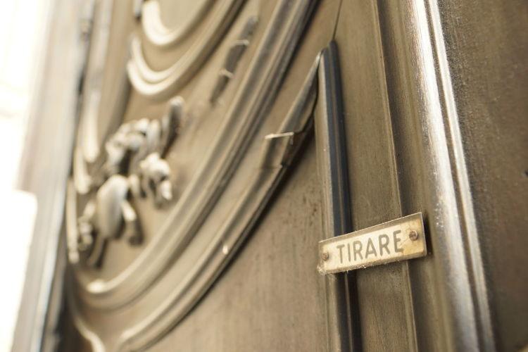Close-up of text on metal door