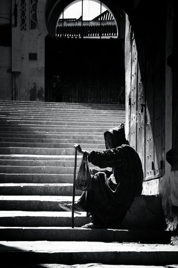 Senior man sitting on steps