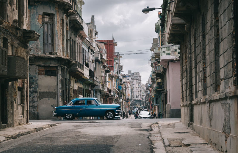 Havana Cuba Streetphotography Architecture Built Structure Transportation Motor Vehicle City Car Building Exterior Mode Of Transportation Land Vehicle Street Building Residential District Sky Road Nature Direction Cloud - Sky Day Incidental People The Way Forward Outdoors Alley