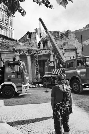 Firefighters and trucks collect the rubble of the earthquake town hall L'Aquila Rubble Wall Black And White Blackandwhite Built Structure Collect Construction Site Construction Worker Crane Earthquake Earthquake L'aquila Firefighters Land Vehicle Manual Worker Men Outdoors Real People Rear View Rubble Ruin Ruined Building Street Town Hall Trucks Working