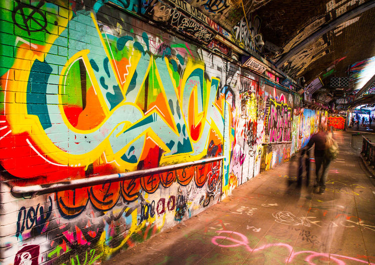Graffiti and street art in the Leake Street Tunnel in London. Colourful Leake St Leake Street Tunnel Leake St Tunnel London Street Artwork Street Artist Architecture Art And Craft Building Exterior Built Structure City City Life Color Creativity Day Graffiti Lifestyles Multi Colored Outdoors Real People Spraying Street Art Text