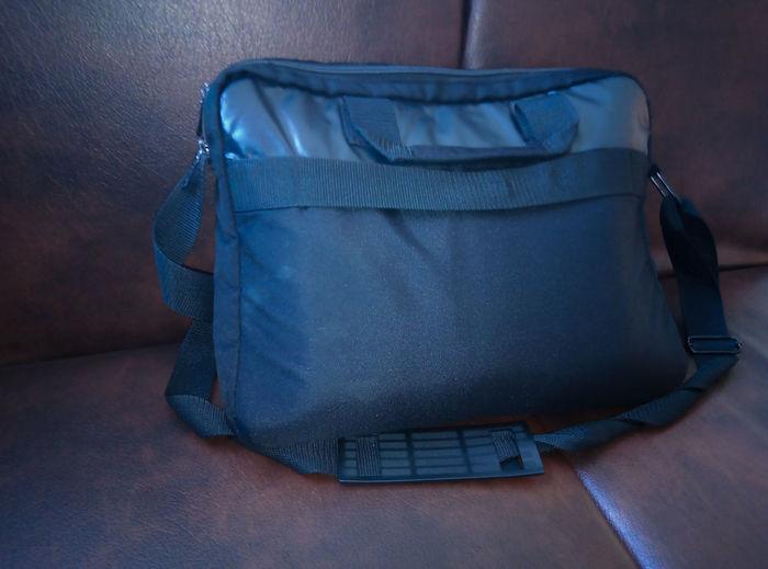 High angle view of messenger bag on sofa at home