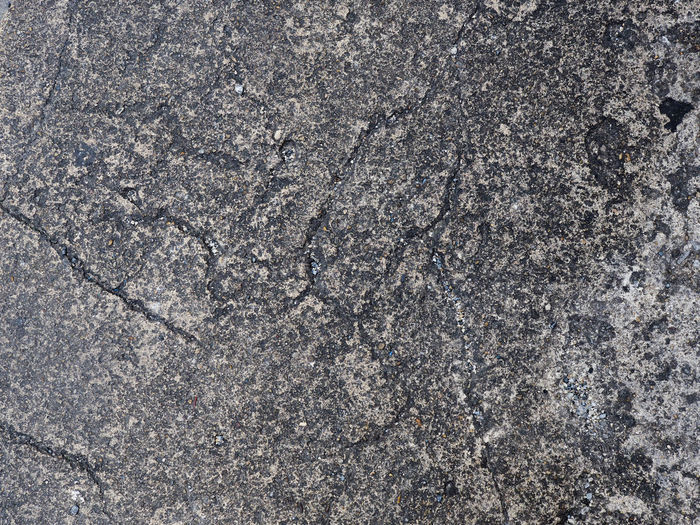 Texture of concrete Street. Background and texture. Abstract Backgrounds Close-up Damaged; Day Destruction; Dirty; Full Frame Gravel; Grey; No People Pattern Street Structure Textured