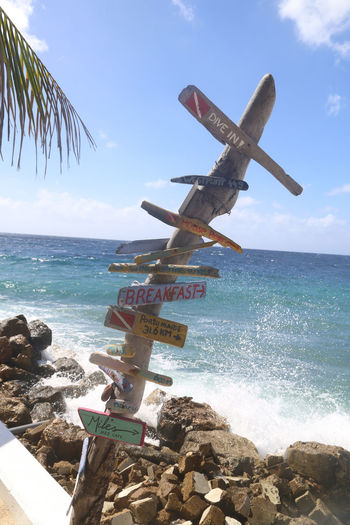 Beach Caribbean Sea Coastline Directions Horizon Over Water In The Distance Ocean Orientation Outdoors Rock - Object Scenics Sea Shore Sign Post Sky Tranquil Scene Water
