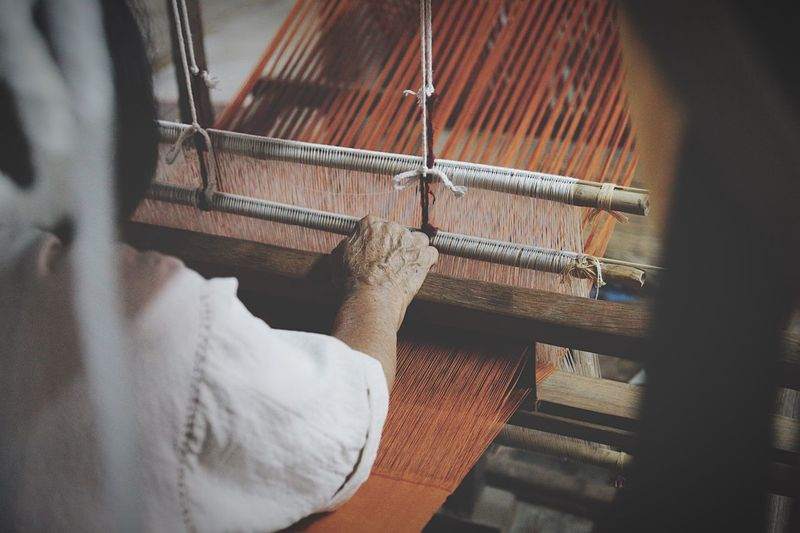 Cropped Image Of Man Using Loom In Textile Industry