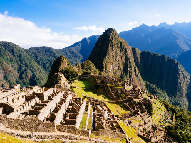 Machu Picchu Ancient Ancient Civilization Architecture Beauty In Nature Built Structure Day History Machu Picchu Mountain Mountain Range Nature No People Old Ruin Outdoors Peru Rocky Mountains Scenics Sky Sunlight Tranquil Scene Tranquility Travel Destinations