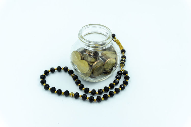 High angle view of decoration in glass jar on white background