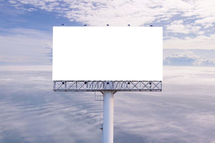 Advertisement Billboard Blank Cloud - Sky Communication Copy Space Day Geometric Shape Information Information Sign Low Angle View Marketing Message Nature No People Outdoors Placard Rectangle Sign Sky Wall - Building Feature White Color