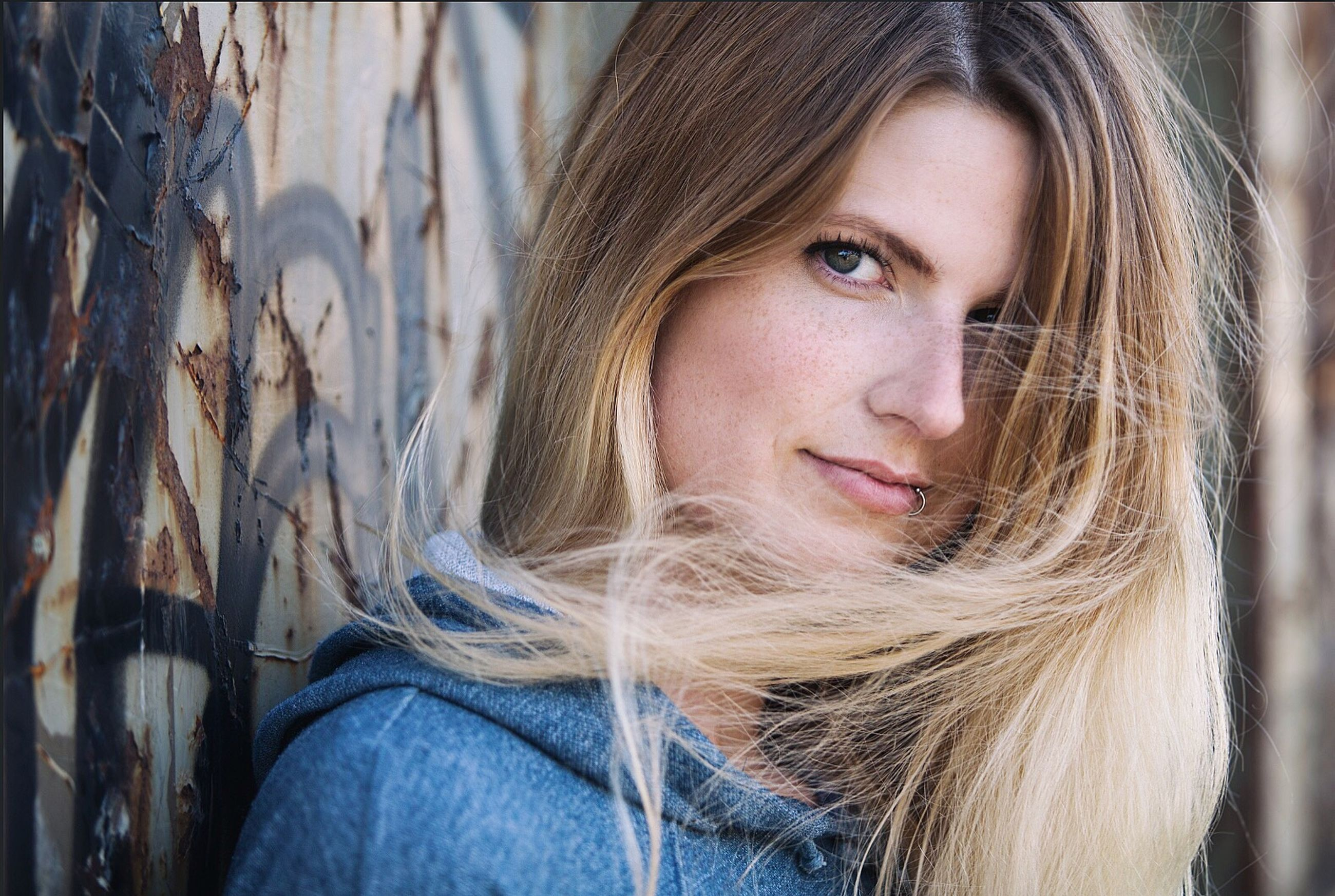 headshot, portrait, one person, long hair, looking at camera, only women, beauty, beautiful woman, blond hair, beautiful people, young women, leisure activity, people, one woman only, close-up, young adult, adult, day, adults only, warm clothing, outdoors, one young woman only