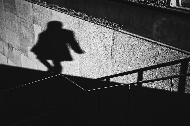 Shadow Series Part 3 VSCO Shadow One Person Light And Shadow Berlin Street Photography Streetphotography Streetphoto_bw Wall Monochrome Woman Blackandwhite Downstairs Light Showcase: December Creative Light And Shadow Real People Side View 35 Mm Sony A6000 The Street Photographer - 2016 EyeEm Awards