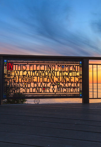 Laguna Beach, California, January 1, 2016: Stained glass fence at Browns Park in Laguna Beach, California at sunset. Architecture Blue Built Structure Closed Cloud Cloud - Sky Day Empty No People Outdoors Sky Sunset, Laguna, Beach, California, Stained, Glass, Fence, Browns, Park, Colorful, Ocean, Sea, Summer, Vacation, Fleeting, Moment, Poem, Tranquil, Relax, Relaxing, Calm, Editorial
