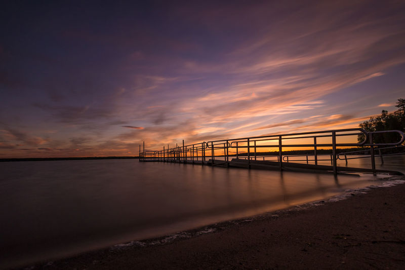 Pier over sea at dusk