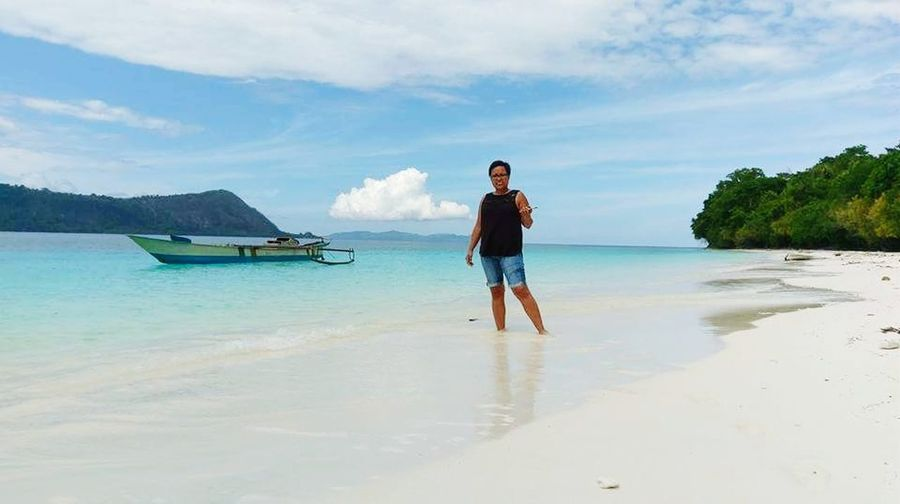 Molana Molanaisland Maluku  Ambon Saparua Full Length Mid Adult Sea One Person Adult Vacations Adults Only People Tranquility Beach Only Men Day Cloud - Sky One Man Only Nature Water Outdoors Standing Travel Casual Clothing