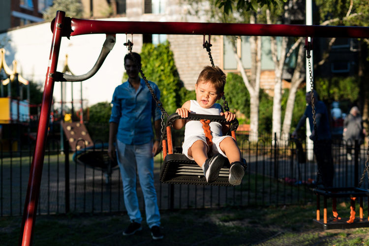 Father and son in the playground Swinging Boys Child Childhood Family Father And Son Full Length Innocence Leisure Activity Males  Men Outdoors Playground Real People Swing Toddler  Two People 50 Ways Of Seeing: Gratitude