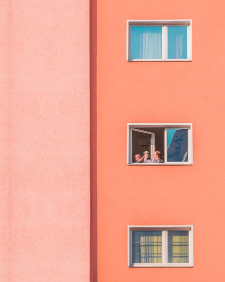 Pastel Power Urban Geometry Architecture Backgrounds Building Building Exterior Built Structure Copy Space Day Full Frame Glass - Material House Low Angle View Minimalism No People Orange Color Outdoors Pink Color Red Reflection Residential District Wall - Building Feature Window Window Frame