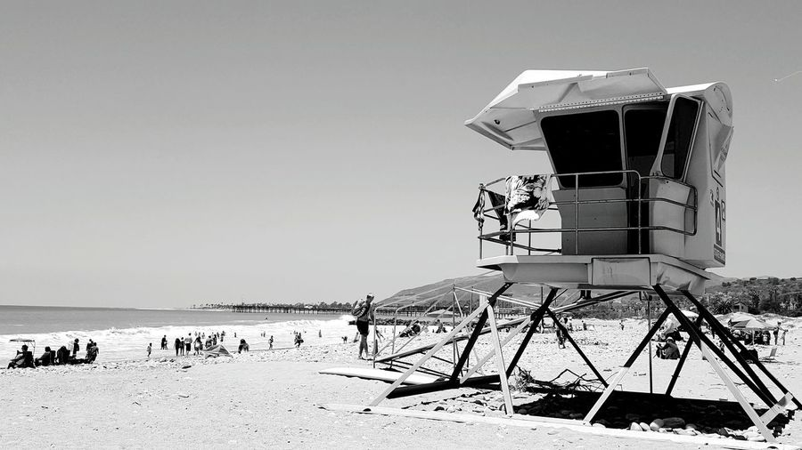 The watcher Protector Looking Over Me Lifeguard  Lifeguard Tower People All Around  Rocky Beach Grey Sky Gray Sky Black And White Portrait People Of The Oceans Protection Life Is A Beach Lifeguard On Duty San Buenaventura Ventura Beach Monochrome Photography
