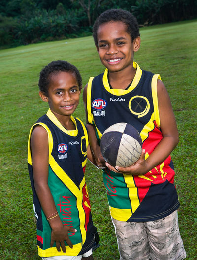 Australian Rules Football Vanuatu Youth Program A.F.L. Australian Rules Football Boys Carlton - Melbourne Casual Clothing Collingwood Communication Front View Grand Final Leisure Activity Looking At Camera Melbourne Cricket Ground Ni Van Pacific Person Portrait Sheeran Smiling Text Togetherness Vanuatu Volcanos Vanuatu Youth Program Vivid International Western Script Young Adult