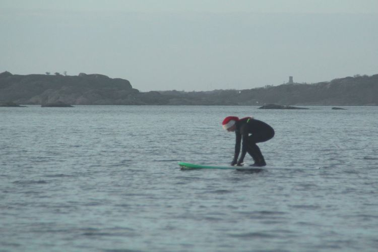 Santa Surfer Christmas Day Cold Temperature Making A Statement  Canonphotography Water Full Length Paddleboarding Adventure Sky Surfer Water Sport Paddling