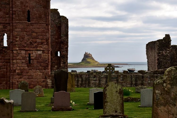 Lindisfarne Castle from Lindisfarne Priory Built Structure Architecture Sky Building Exterior The Past History Cloud - Sky Nature Day No People Outdoors Church Church Yard Cemetery Graveyard Headstone Priory Castle Mound Hill Castle View  Bay Sea Sea And Sky Stone Building Historic Historical Building Lindisfarne Island Holy Island Lindisfarne Castle Lindisfarne Priory Tranquility Tranquil Scene Relaxing Calm Peace Architecture