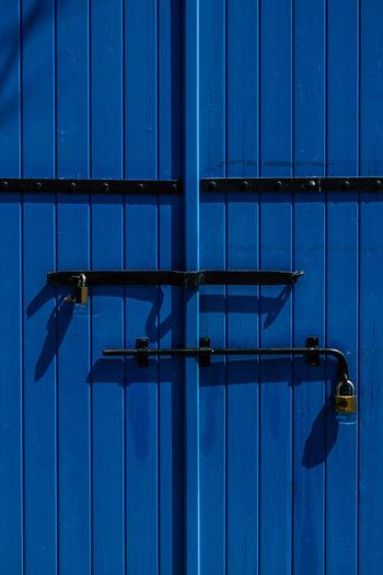 Full frame shot of closed blue wooden door