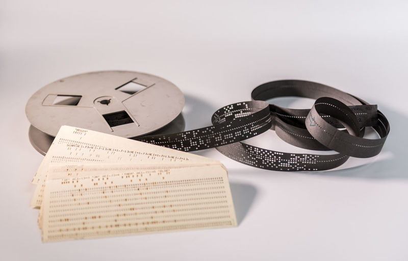 Close-up Computing On White Paper Paper Tape Punched Card
