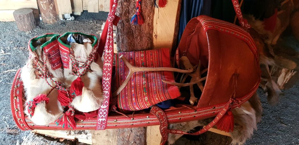 A Sami (Nordic ethnic tribe) baby carrier and boots with a bag and some reindeer people are semi-nomadic and reindeer herding is only reserved for them. Baby Child Winter Cold Baby Carrier Red Boots Hide Reindeer Antlers Samit Lapp Cradleboard EyeEm Selects Close-up