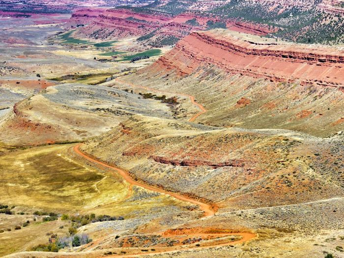 Dirt road Red Rocks  Arid Climate Desert Beauty Wyoming Landscape_photography Landscape_Collection Wyoming Landscape Landscape Tranquil Scene Scenics High Angle View Outdoors Nature Geology Tranquility Day No People Physical Geography Travel Destinations Beauty In Nature Arid Climate Mountain