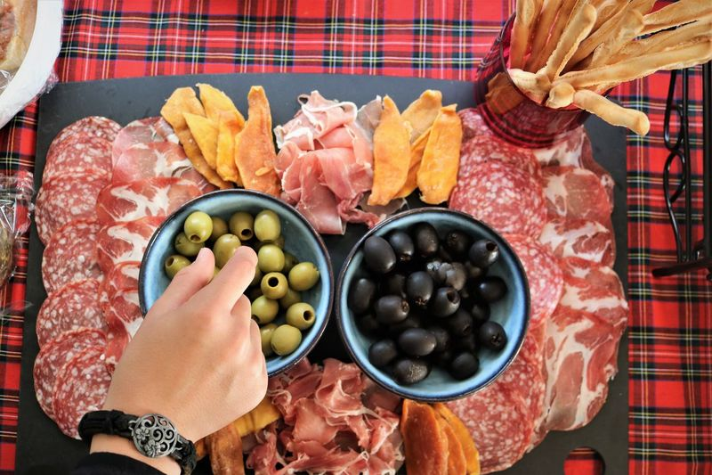 Hors d'oeuvres Hors D'oeuvres Platter Finger Food Food Food And Drink Olive Human Body Part Human Hand One Person Black Olive Green Olive Holding Freshness Healthy Eating Wellbeing Party Party Food Nibbles Directly Above Choice Parma Ham Prosciutto Bread Sticks  Salami Table Cloth My Best Photo Moms & Dads British Culture Exploring Fun The Minimalist - 2019 EyeEm Awards The Foodie - 2019 EyeEm Awards
