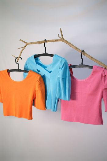Clothes drying on clothesline against white background