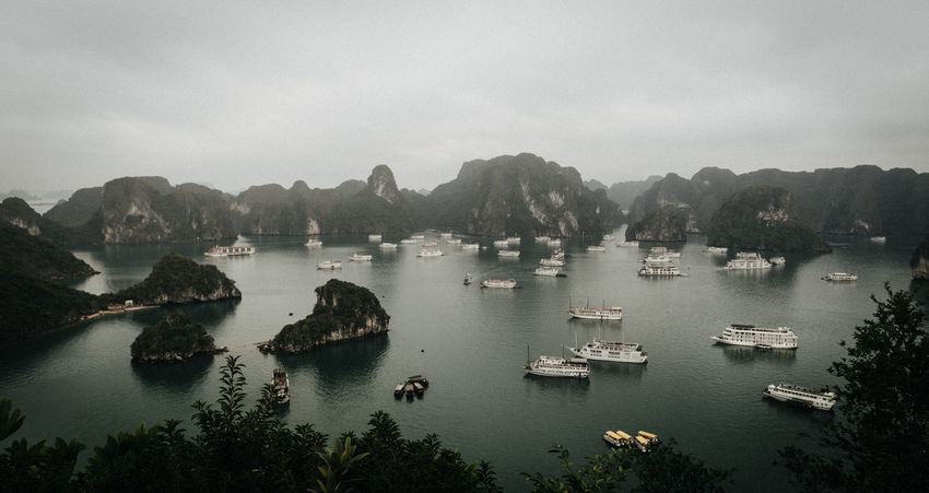 Boats in Ha Long Bay, Vietnam Architecture ASIA Bay Beauty In Nature Boats Boats⛵️ Clouds Clouds And Sky Day High Angle View Landscape Mountain Nature Nautical Vessel No People Outdoors Scenics Sky Tranquility Transportation Travel Tree Vietnam Vietnamese Water