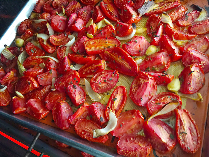 Roasting tomatoes with onion and garlic Abundance Baking Sheet Close-up Cut Up Food Food Preparation Fresh Oregano Garlic Harvest Many Natural Light No People Nobody Onion Oven Overhead Phone Camera Preserving Food Red Roasting Textures Tomato Wedges Tomatoes Vegetables