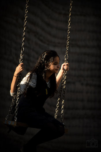 Young woman enjoying on swing
