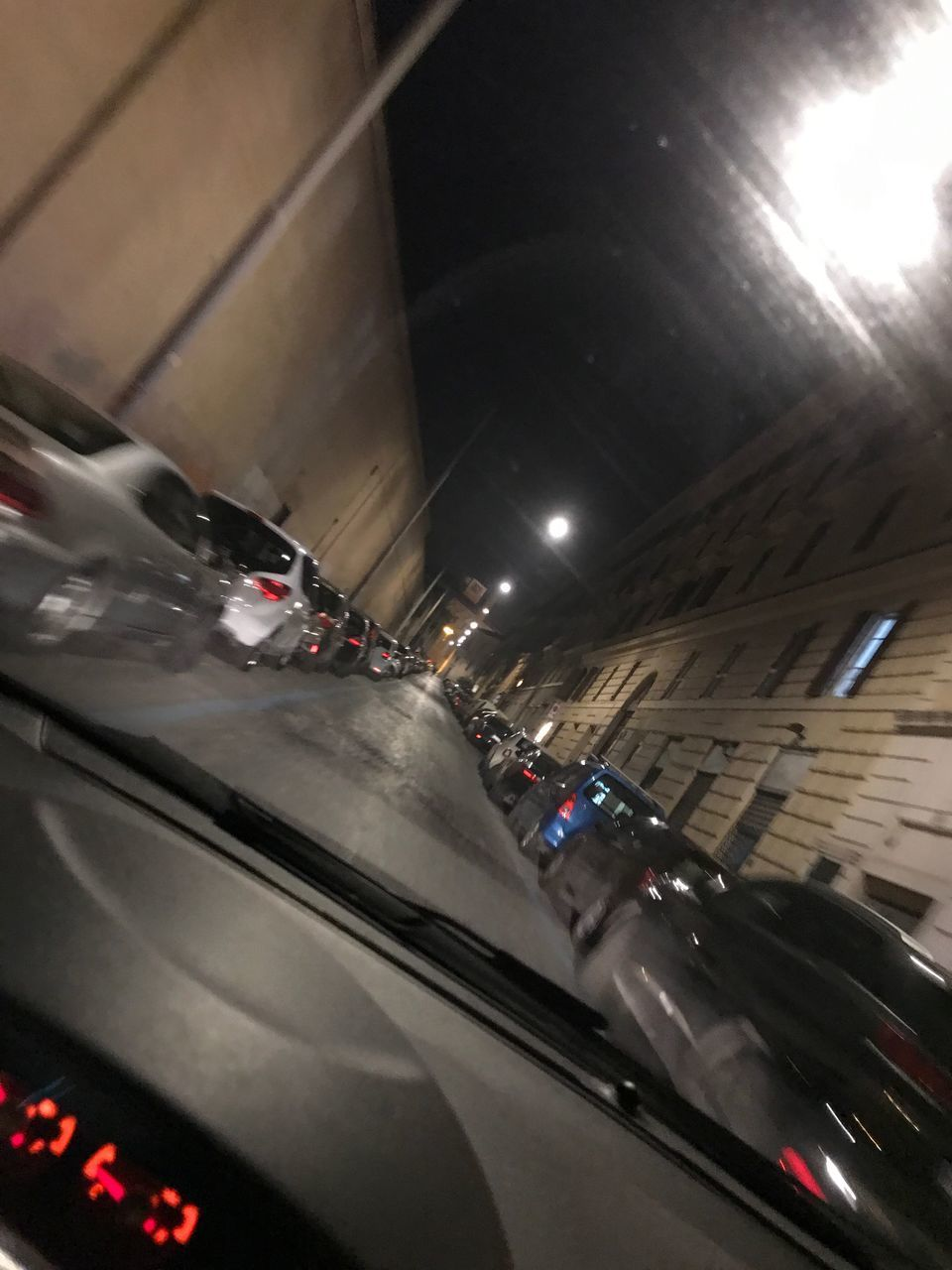 transportation, mode of transportation, car, illuminated, motor vehicle, architecture, land vehicle, motion, indoors, city, on the move, travel, road, night, vehicle interior, built structure, windshield, lighting equipment, high angle view, incidental people, car point of view, ceiling