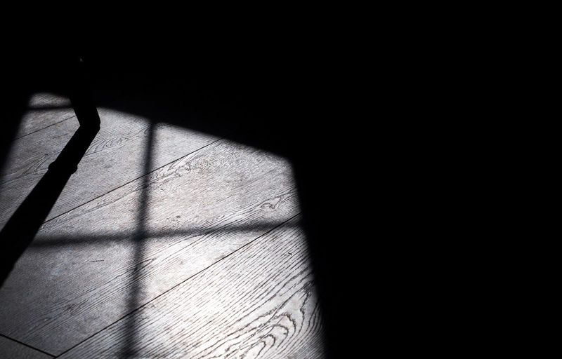 Close-up of shadow on black background