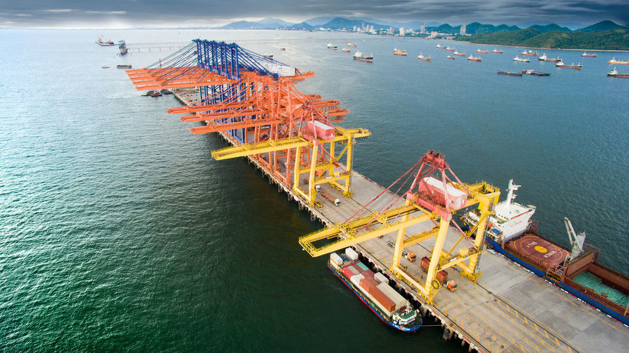 High Angle View Of Cranes In Sea