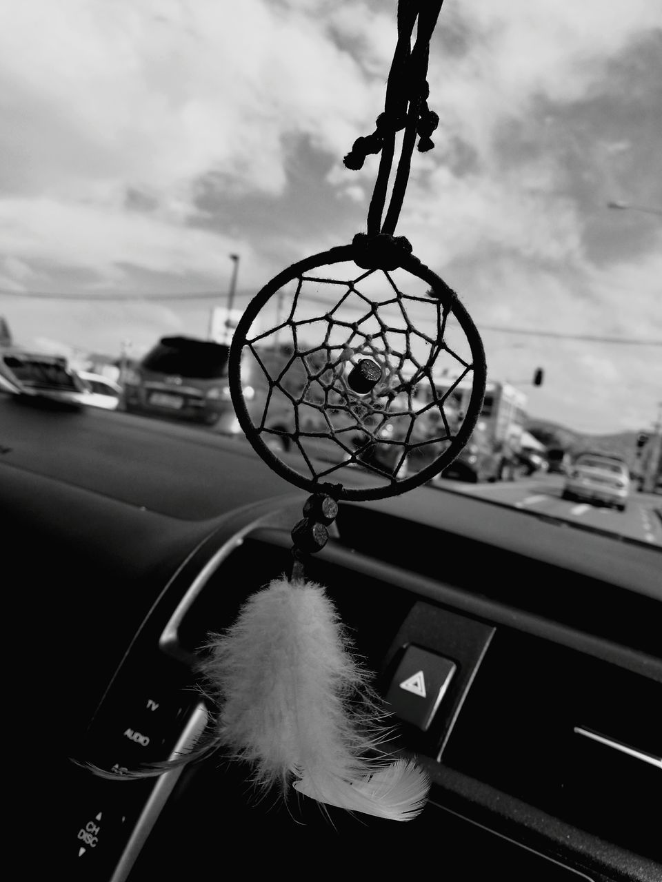 dreamcatcher, hanging, car, sky, transportation, car interior, cloud - sky, mode of transport, land vehicle, no people, focus on foreground, close-up, day, outdoors, hope