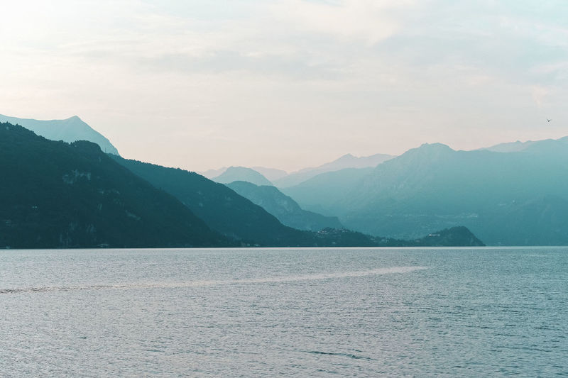 Como Beauty In Nature Blue Day Lake Landscape Lecco Mountain Mountain Range Nature No People Outdoors Scenics Sky Tranquil Scene Tranquility View Into Land Water