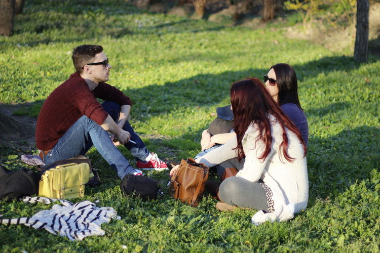 Group of people sitting on grass